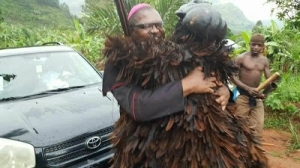 Excited Masquerade Poses With Catholic Priest After Meeting Him On The Road (Photos)
